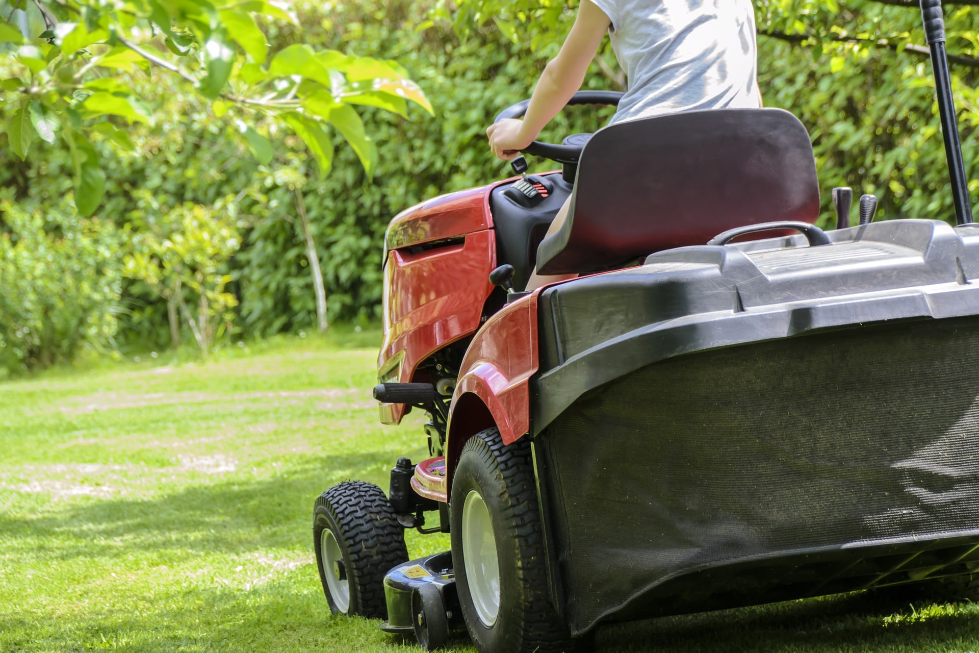 A ride on mower with a grass box.