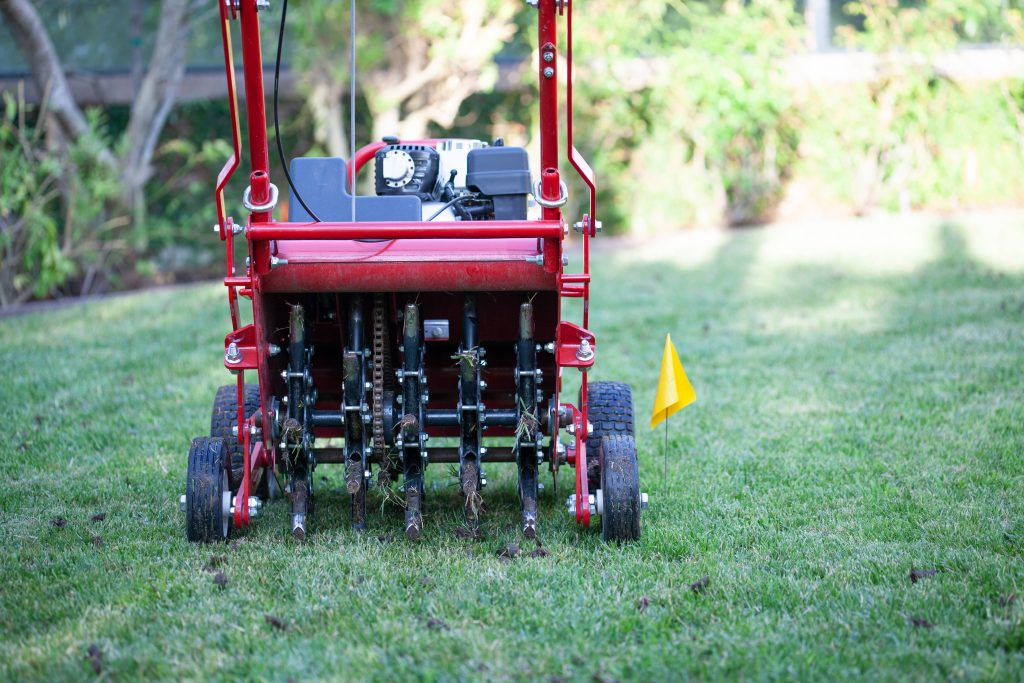 Powered hollow tine lawn aerator.