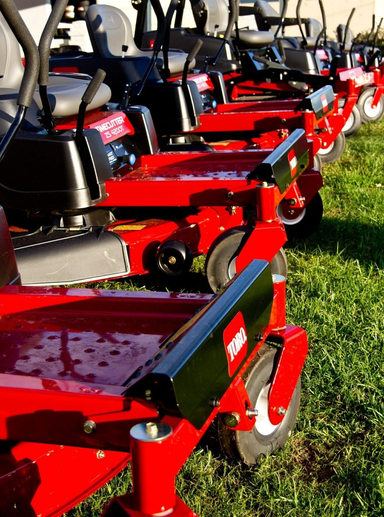 Number of petrol powered Toro ride-on lawn mowers.