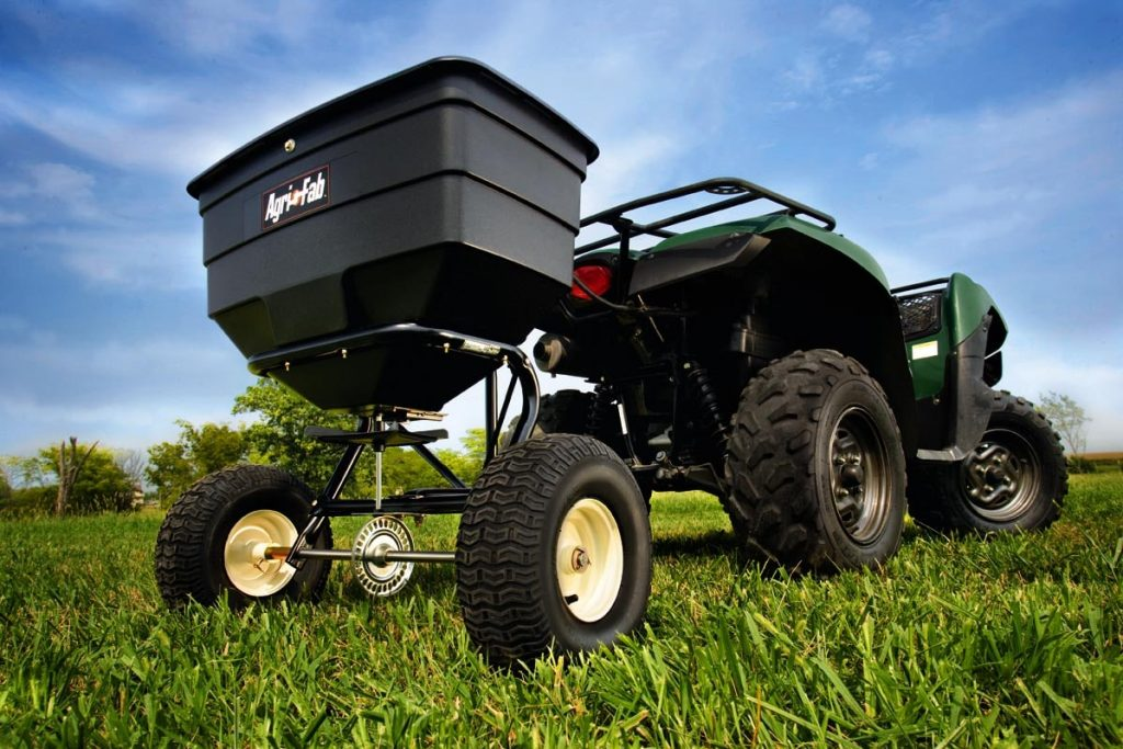Tractor based rotary lawn spreader.