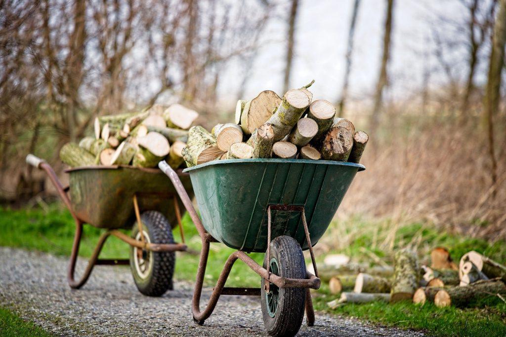 Wheelbarrows full of logs.